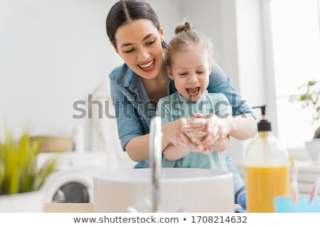 Little girl about to wash her hands with soap Stock photo © lovleah