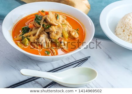 Chicken soup with vegetables in bowl with chop sticks stock photo © janssenkruseproducti