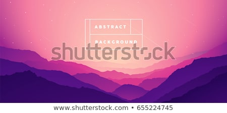 bright sunrise the mist in a mountain valley and mountain peaks stock photo © alinamd