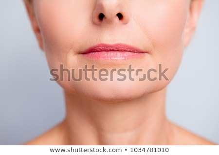 Cropped image of young woman make lip injections. Stock photo © deandrobot