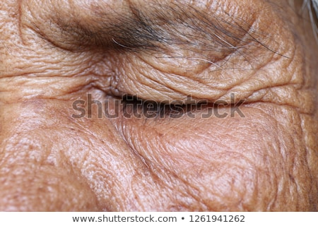 Beautiful woman with eyes closed and looking to the left Stock photo © deandrobot
