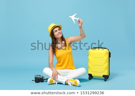 business woman sitting on travel case Stock photo © svetography