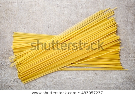 dried spaghetti and raw egg stock photo © digifoodstock