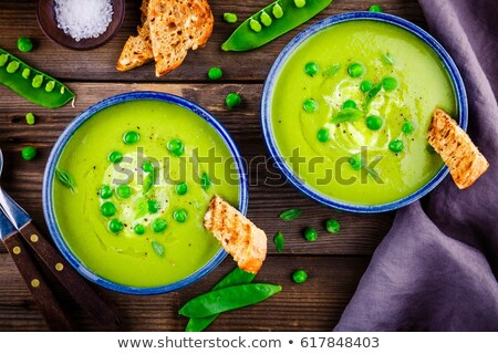 Fresh green peas on dark wooden rustic background Stock photo © yelenayemchuk
