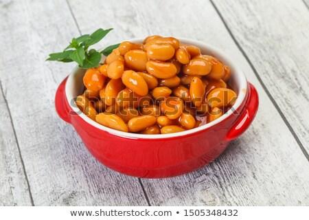 Frijoles salsa de tomate tazón fondo blanco Foto stock © Digifoodstock