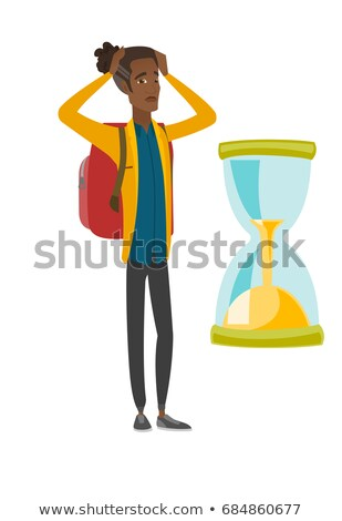Worried african traveler man looking at hourglass. Stock photo © RAStudio