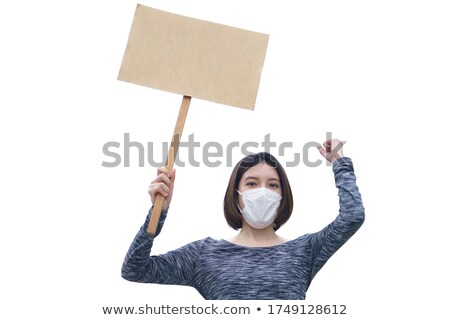 Lady holding blank with text about feminism Stock photo © deandrobot