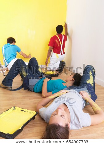 Men painting girls have a nap. Stock photo © IS2