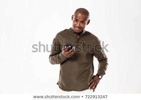 Sonriendo África hombre brazo cadera Foto stock © deandrobot
