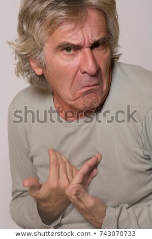 Man frowning and making innocent gesture Stock photo © IS2