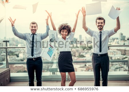 Three female colleagues throwing paper Stock photo © IS2