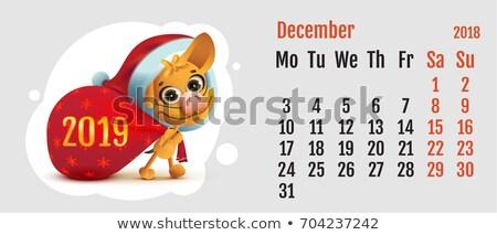 Foto stock: 2018 Year Of Yellow Dog On Chinese Calendar Fun Santa Dog Carries Bag Calendar Grid Month December