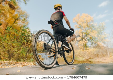 Man with road bike looking at river view in park stock photo © blasbike