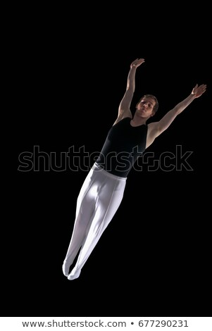 gymnast outstretched in mid air Stock photo © IS2