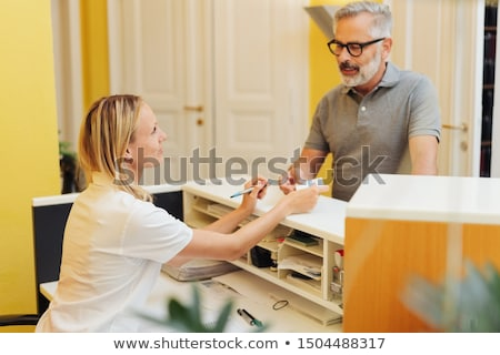 doctor and receptionist in surgery stock photo © is2