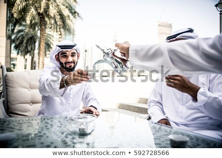 Barbudo árabe empresários café reunião escritório Foto stock © studioworkstock