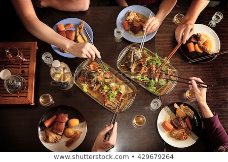 Friends eating chinese food in kitchen Stock photo © IS2