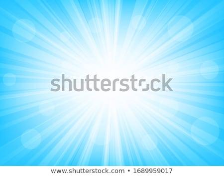 abstract blue sunburst stock photo © milsiart