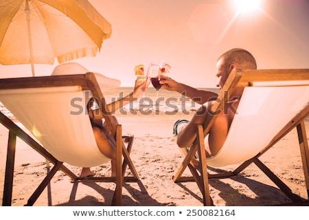 Hartelijk paar zon vrouw bikini zwembad Stockfoto © IS2