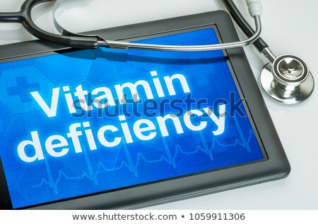 Tablet with the text vitamin deficiency on the display  Stock photo © Zerbor