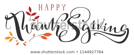 happy thanksgiving ornate hand written calligraphy text and fall leaf stock photo © orensila