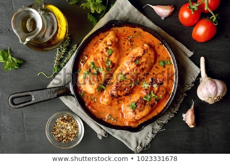 roasted whole chicken in cast iron black pan stock photo © dash