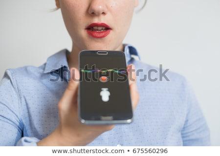 Donna voce smartphone ufficio uomini d'affari Foto d'archivio © dolgachov