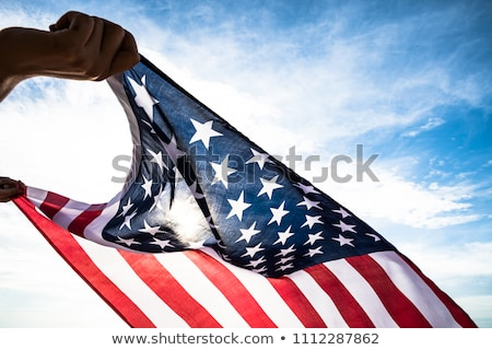 Stock photo: close up of woman holding american flag in hand