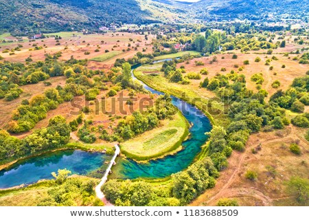 Majerovo vrilo Gacka river source and valley aerial view stock photo © xbrchx