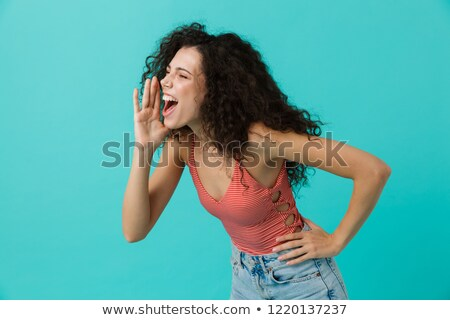 Image of joyous woman 20s wearing casual clothing screaming and  Stock photo © deandrobot