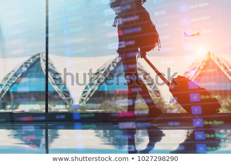 Double exposure with silhouettes of passengers in the airport waiting for boarding Stock photo © alphaspirit