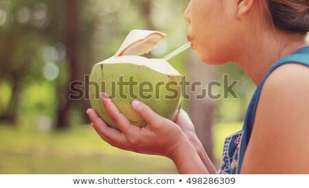 Bella ragazza bere cocco acqua ritratto Foto d'archivio © Anna_Om