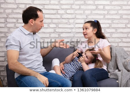 parents arguing at home while her daughter using mobilephone stock photo © andreypopov