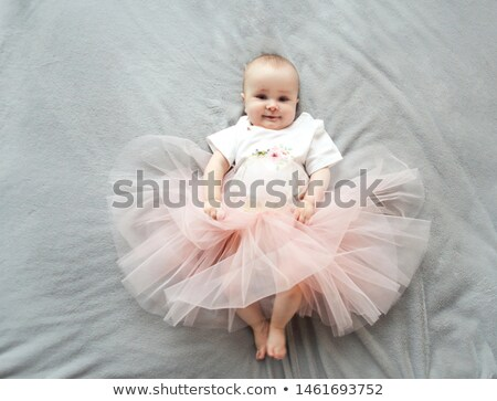 Adorable baby girl wearing tu-tu skirt on the bed  Stock photo © dashapetrenko