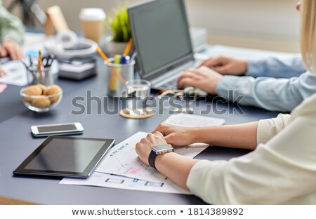 close up of ui designer with tablet pc at office stock photo © dolgachov