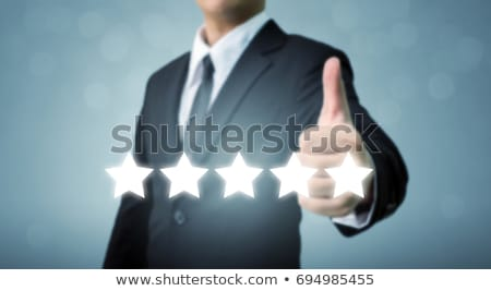 Businessman Showing Thumb Up Sign With Five Star Stock photo © AndreyPopov