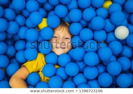Child playing in ball pit. Colorful toys for kids. Kindergarten or preschool play room. Toddler kid  Stock photo © galitskaya
