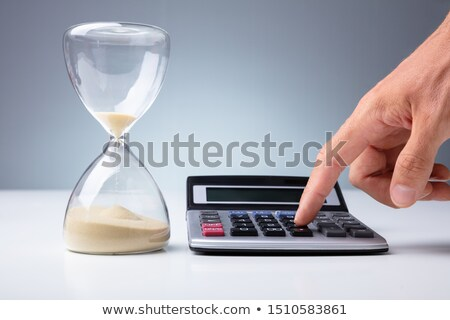 Persoon calculator zandloper hand Stockfoto © AndreyPopov