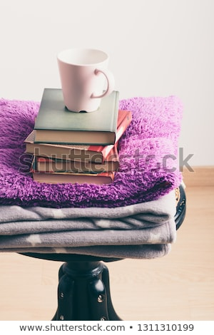 A few books with cup of coffee and blanket on wooden chair Stock photo © przemekklos