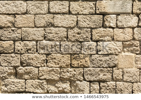 Ancient walls and laying of old stones. Stock photo © Zhukow