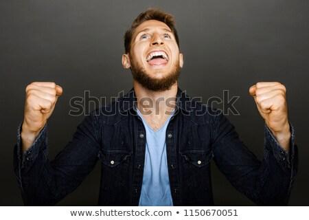 Feliz mirando hombre ganar gesto Foto stock © Giulio_Fornasar
