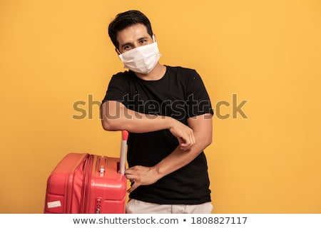 man with a suitcase and a surgical mask Stock photo © nito