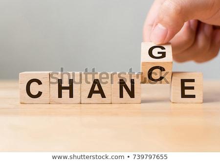 change word in hand stock photo © ansonstock