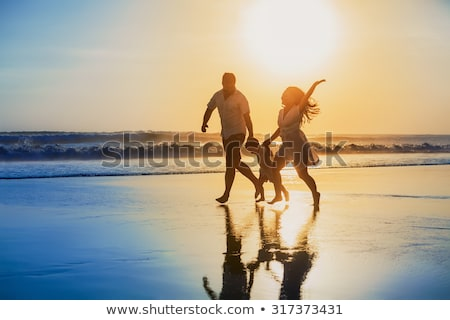 mother with son running on edge of sea stock photo © paha_l
