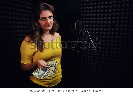 Skeptical Caucasian Woman Holding Microphone White Background Stock photo © Qingwa
