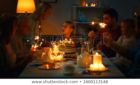 mother bringing a cake at a birthday party Stock photo © photography33