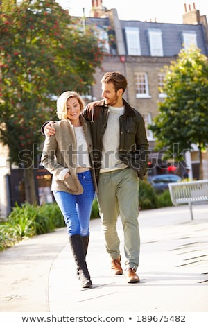 Young couple walking through city Stock photo © photography33