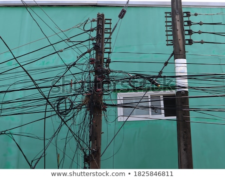 messy electric cables Stock photo © smithore