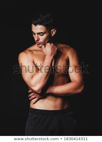 Izmos férfi fiatal afroamerikai afroamerikai férfi póló Stock fotó © piedmontphoto