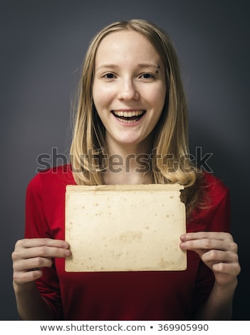 Blond teenager holding blank sheet of paper Stock photo © photography33